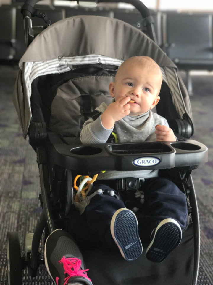 baby eating cookies airport