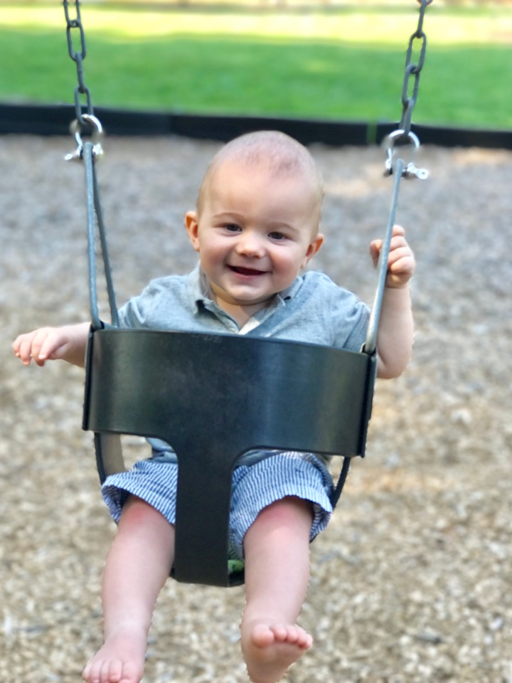 baby-swinging-park